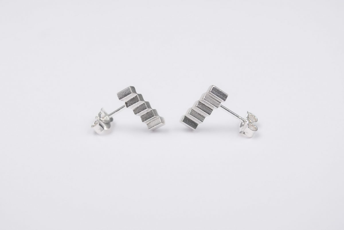 silver earrings diagonal shiny white silver . front view