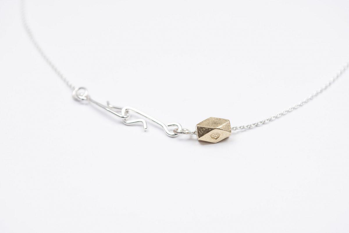 necklace etalon artefakti one 18 karat golden element size L. minimalistic look side view